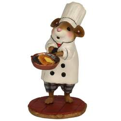 Chef mouse with copper skillet full of delicious morsels.