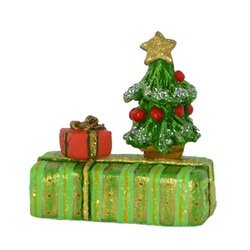 Two wrapped gifts with small Christmas tree
