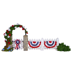 Picket fence with gate and rose covered arch decorate for July 4t