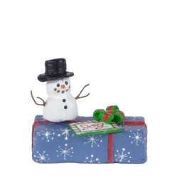 Snowman sitting atop of a Christmas package