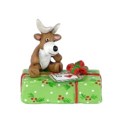 Reindeer toy sitting on a Christmas gift package