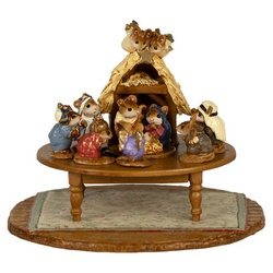Annette originally sculpted the Nativity scene in 1984. Here it is displayed atop a table on a beautifully highly detailed holiday carpet.