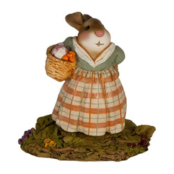 Missus Bunny carries a basker of seasonal root veggies