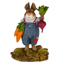 Mr. Harvest Bunny hold up his prize carrots and beets