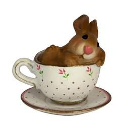 Snuggly bunny found taking a nap in a tiny tea cup.