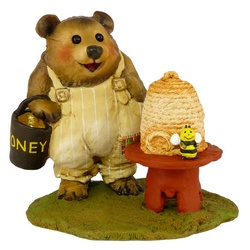 Bear bee keeper with hive