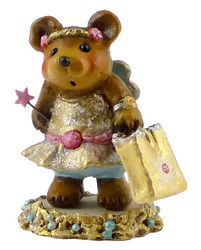 Bear dessed in party frock with wings, a  wand and large carrier bag