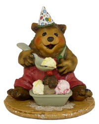 Bear sitting with party hat and a large bowl of ice-creams