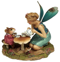 A fairy and a young girl mouse have tea at a toadstool table