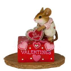 Girl mouse standing on her Valentine's box