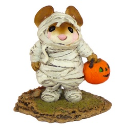 Young mouse wrapped in bandages carrying a pumpkin candy bucket