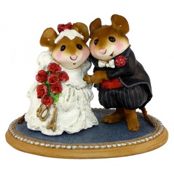Bride and groom mice pose in formal wedding attire