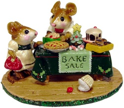 Bakes sale with a table full of Christmas goodies