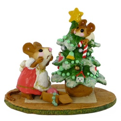 Mother mouse shocked to find her child up a Christmas tree