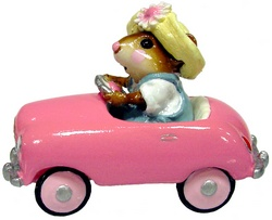 Girl mouse in spring hat driving pink pedal car