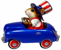 Yankee Doodle driving patriotic peddle car with stars and stipes tophat