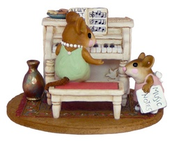Young girl mouse coming up for her piano lesson
