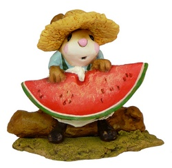 Boy with straw hat eating large slice of water mellon