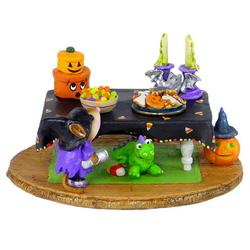 Table with small mouse and Halloween decorations