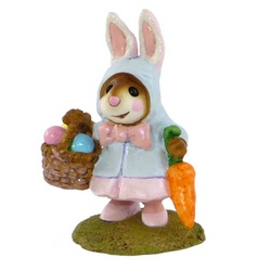 Girl mouse in rabbit coat with Easter basket and carrot