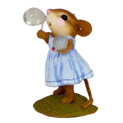 Young girl mouse blowing bubbles