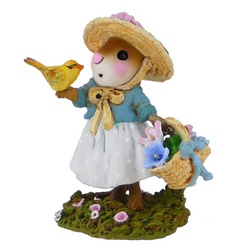 Young lady mouse with basket of flowers in one hand and a bird on the other