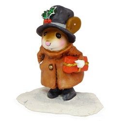 Mouse with top hat and overcoat carring a Christmas package through the snow