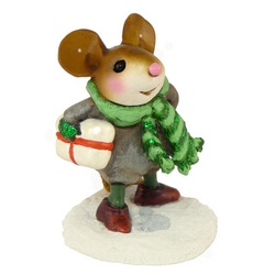 Youg mouse with scarf trecking through snow holding package