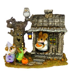 Spooky house and animated tree with owl lady mouse hold out candy for two trick or treaters