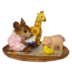 Very young girl mouse reads to her animal toys