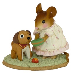 Young girl mouse feeds her stuffed toy dog
