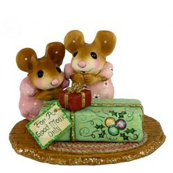 Two mice looking at Christmas packages