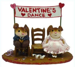 Young couple sitting on chair appart at the Valentines dance