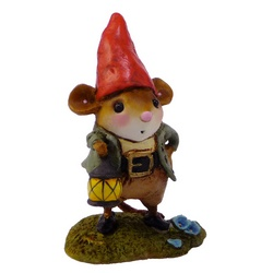 Male mouse dessed as a gnome holding a lamp in right hand