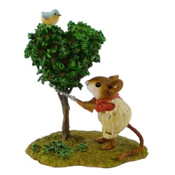 Gardener mouse trims heart shaped tree with blue bird on top