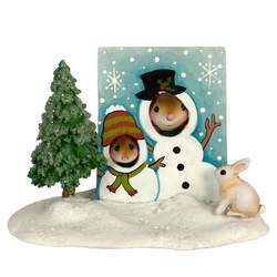 Two mice pose for a photo through a snowman screen