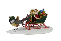 Mouse Santa in sleigh with toys pulled by a bird
