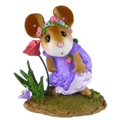 Girl mouse holds her dress down while looking a flower