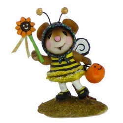 Mouse in bee costume holding flower wand in one hand and pumpkin bucket in other