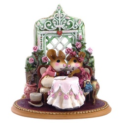 Mouse couple in fall Victorian dress sit at a table looking at a diamond ring