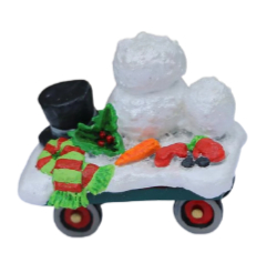 Flat train car with all you need for the perfect snowman.