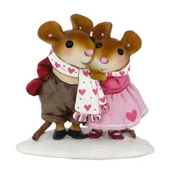 Two mice in the snow sharing a Valentines scarf