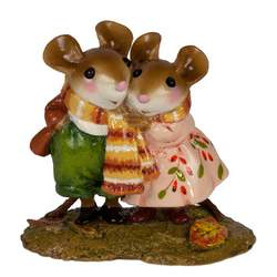 Two mice in love, wrapped together in a long scarf.