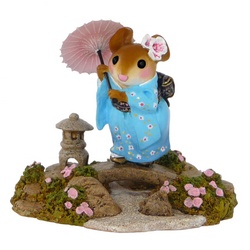 Traditionally dressed Japanese lady mouse with an umbrella in her garden