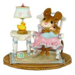 Mother mouse in a rocking chair with baby on her knee