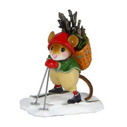 Mouse skier in Elf colors carrying a basket full of firewood