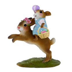Young girl mouse ridding a bunny and carring an Easter basket