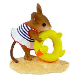 Girl mouse in a swim suite with duck ring