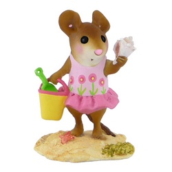 Girl mouse in floral swim suite with bucket, spade and conch shell