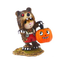 Mouse in bear costume with pumpkin